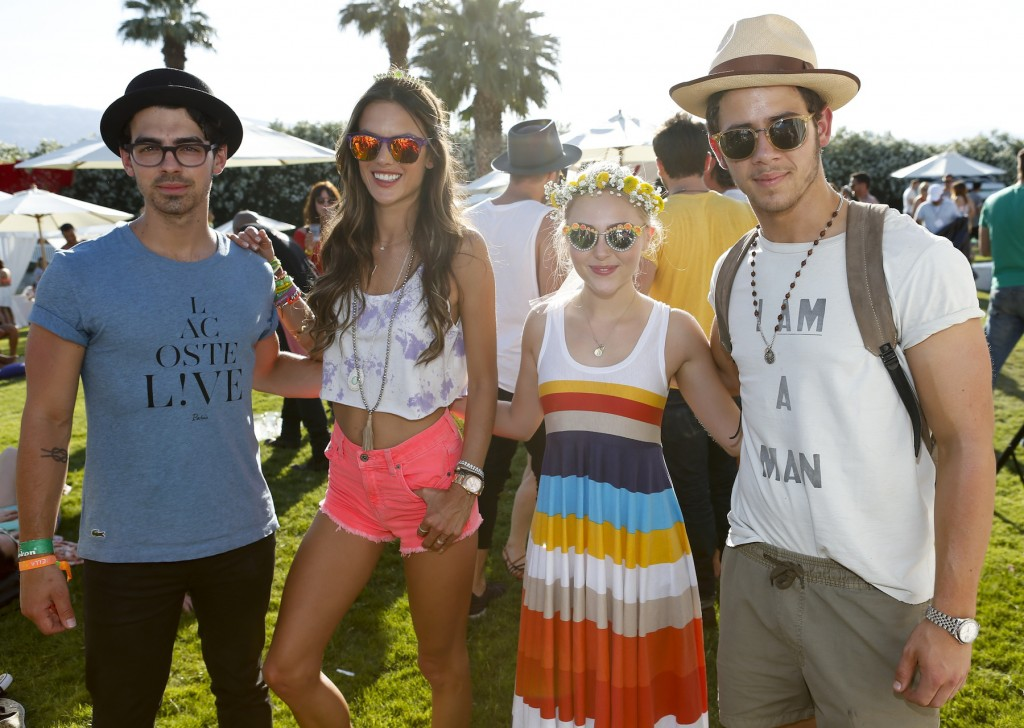 PALM SPRINGS, CA - APRIL 13:  (L-R) Musician Joe Jonas, model Alessandra Ambrosio, actress AnnaSophia Robb, and musician Nick Jonas attend the FIJI Water At Lacoste L!VE Coachella Desert Pool Party on April 13, 2013 in Palm Springs, California.  (Photo by Imeh Akpanudosen/Getty Images for FIJI)