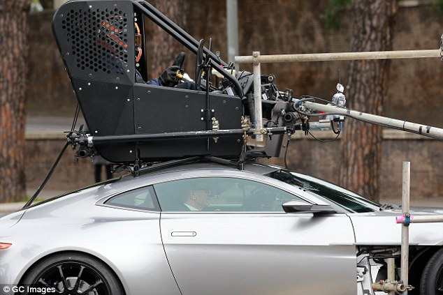 Stunt Driver on top, Daniel Craig at the wheel