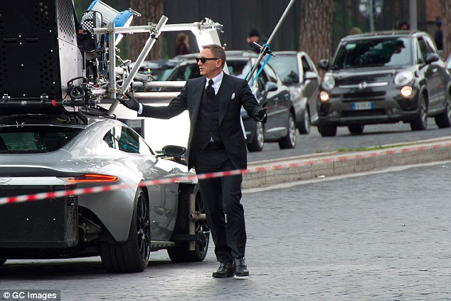 Daniel Craig on set with Aston Martin DB10